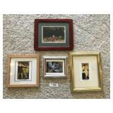 Four small framed art prints