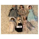 Three vintage dolls.