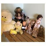 Eleven vintage dolls