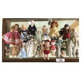 30 small vintage dolls