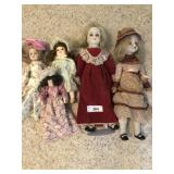 Five vintage porcelain dolls