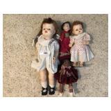 Four vintage pocelain dolls