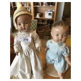 Two vintage composition dolls on dollstands