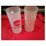 2 coke glasses and two plates
