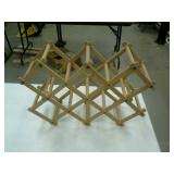 Collapsible wooden wine rack.