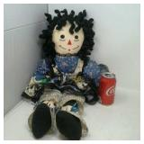 Vintage rag doll in cow dress.