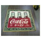 "Coca-Cola throw rug, approximately 25""×25""."