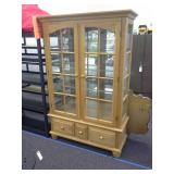 Wooden lighted cabinet with glass front and
