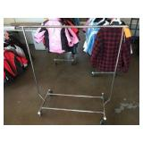 Chrome clothing rack on wheels