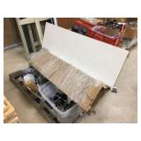 Pallet of chrome peg board attachments, table