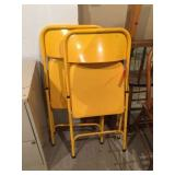 2 yellow folding chairs