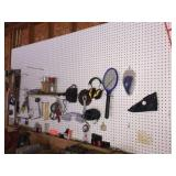 Tools & assorted contents on peg board