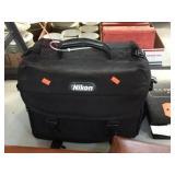 Nikon 35mm camera w/ accessories in bag