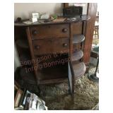 Vintage cabinet with shelves drawers and a glass