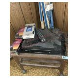 Small table with VCR and seven new VHS tapes
