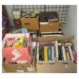 Large group of books, CDs, and VHS tapes