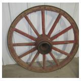 """Wood wagon wheel. Measures 41"""" across."""