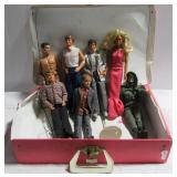 Various Ken and Barbie dolls and Barbie carrying