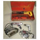 Various garage items including DeWalt sawzall,