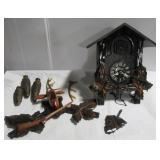 Vintage cuckoo clock depicting deer. Note: Shows