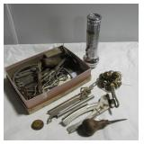 Various vintage bottle openers, bells,