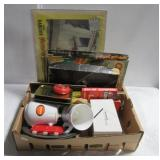 Box full of various items including Superman mug,