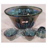 Blue carnival glass punch bowl set.