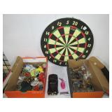 Cork dart board, various toy cars and figures,