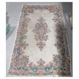 """Area rug. Measures 60"""" x 36"""". Shows wear."""