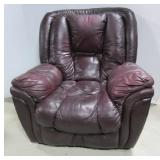 Leather rocking recliner. Note: shows some wear.