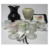 Glassware items including vases, coffee cups,