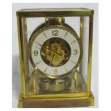 "LeCoultre dome clock. Measures 9"" h x 7"" w x 5"""