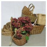 Large group of various size wicker basket.
