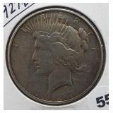 1927-D Peace Silver Dollar.