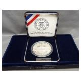 1992 White House proof silver dollar.