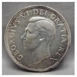 1949 Canadian silver dollar. Light toning.