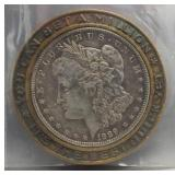 1889 Morgan silver dollar with Buick metal frame.