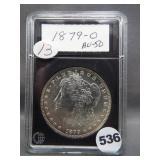 1879-O Morgan silver dollar in Coin World holder.