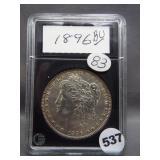 1896 Morgan silver dollar in Coin World holder.