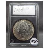 1888 Morgan silver dollar in Coin World holder.