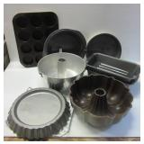 Baking and kitchen items including bundt pans,