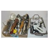 Box filled with kitchen utensils including