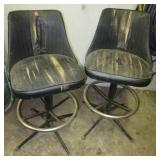 (2) Swivel chairs. Both show wear.