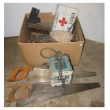 Hand saws, battery charger, first aid box, table