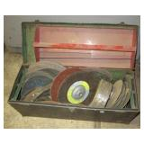 Metal tool box filled with various size sanding