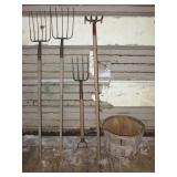 Bushell basket with (2) pitch forks, potato fork,