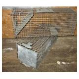 (2) Medium size animal traps.