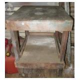 Homemade two tier garage bench on castors.
