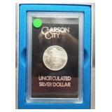 1885-CC GSA UNC Morgan silver dollar with box.