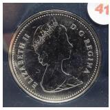 1983 Canadian brilliant silver dollar. 50%